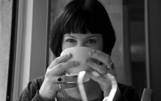 Jen drinking tea at breakfast in Paris. Photo by Arlo.